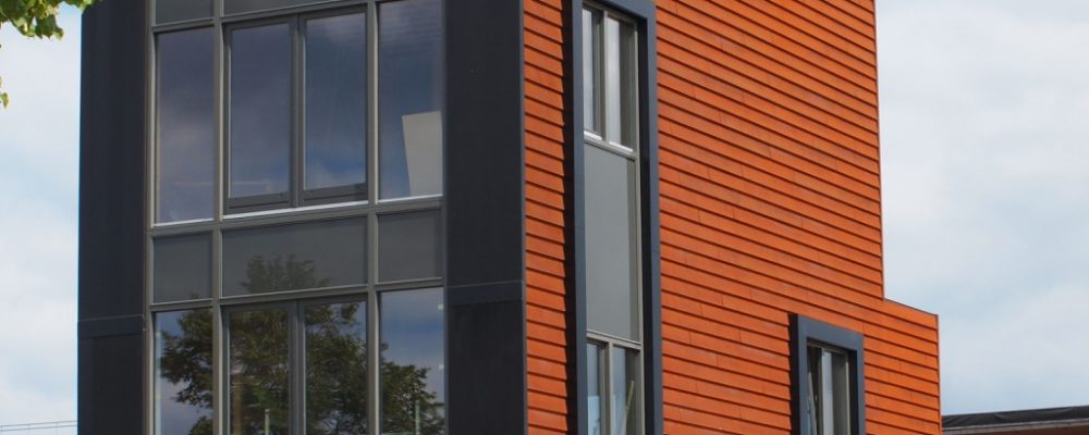 Buiksloterham studio home energy efficient with Triple Solar facade PVT heat pump panel
